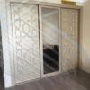 Встроенный шкаф с золотым фасадом